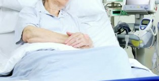 stock-footage-elderly-female-caucasian-lady-sleeping-in-a-hospital-bed-recoverying-from-illness