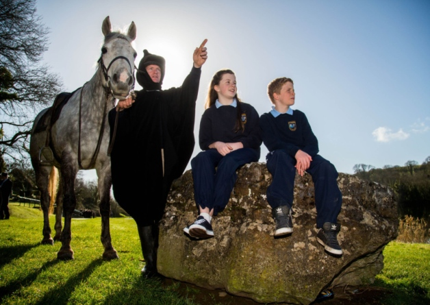 Seamus Murnane as Gearoid Iarla takes time out to tell students of Lough Gur National School, Ali Carew and Cameron Mallory, the tale of Gearoid Iarla, the third Earl of Desmond. Picture: Alan Place